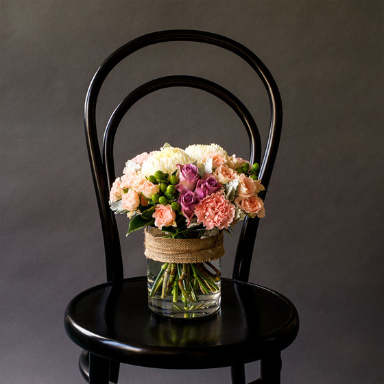 Mother's Day flowers in vase on chair