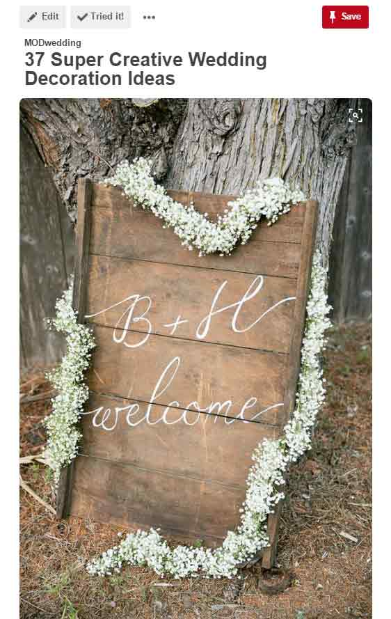 babys breath on wedding welcome sign