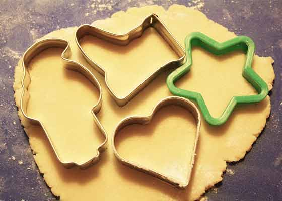 Cookie dough with Christmas cookie cutters