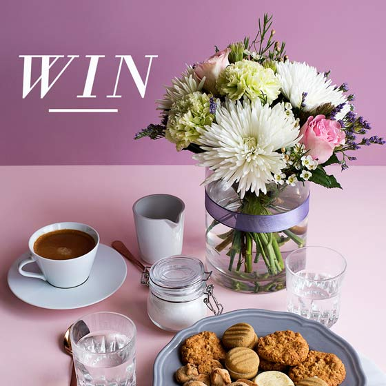 white and pink flowers on table with afternoon tea win image