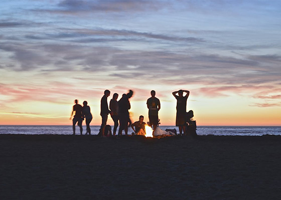 People having a bonfire on the beach