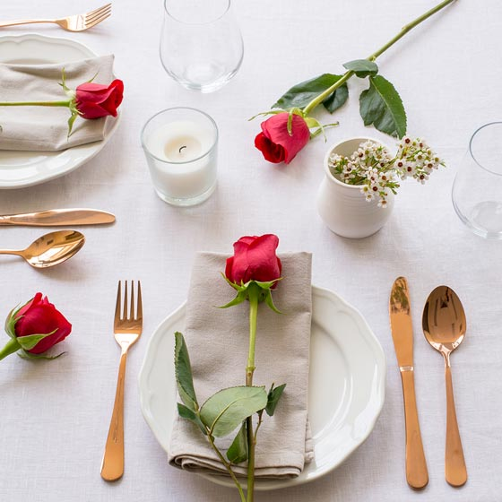 romantic table setting with red roses