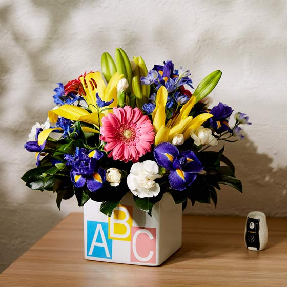 bright coloured flowers in ABC ceramic cube vase