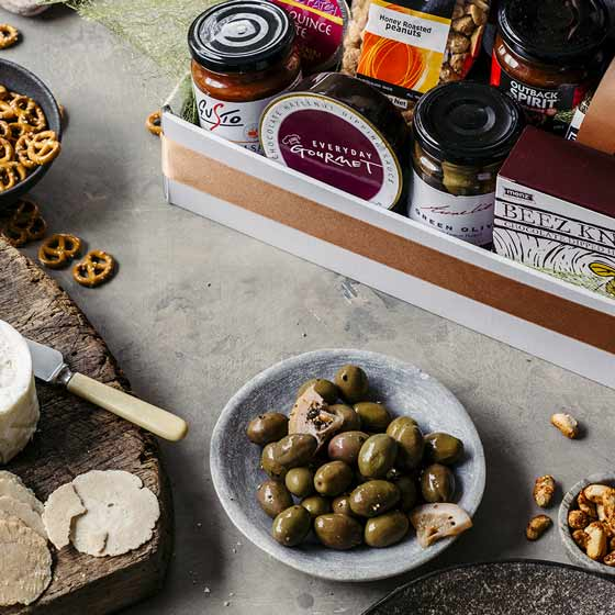 gourmet food hamper with olives and cheese