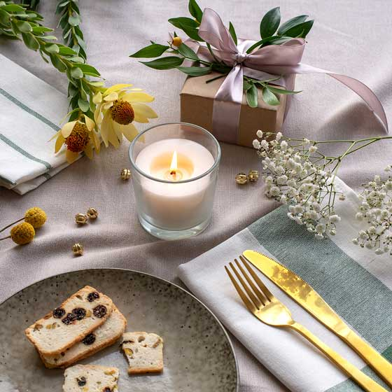 Christmas table with small wrapped present and candle