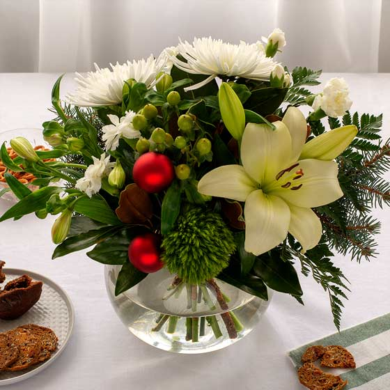 Christmas flower arrangement in fishbowl vase