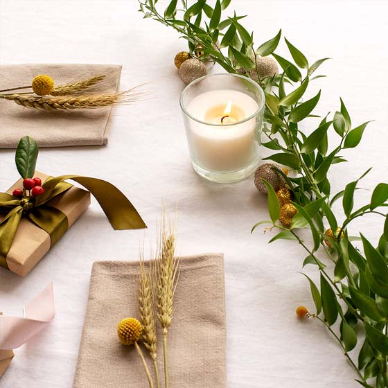 Christmas table with neutral foliage and candle