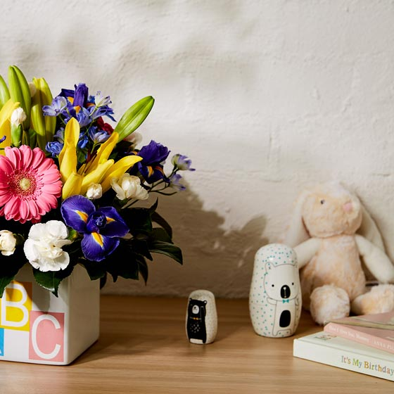 new baby flowers and stuffed rabbit