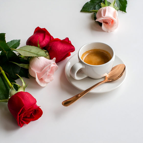 pink and red roses with coffee