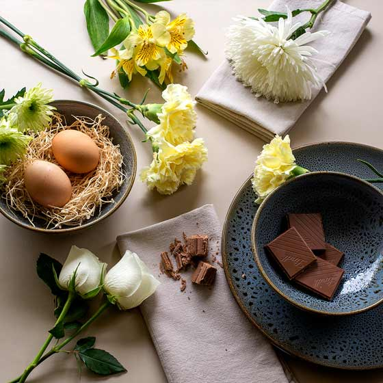 easter flowers and chocolate table setting