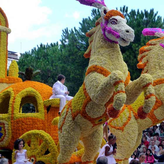 flower horses pulling a carriage on a float