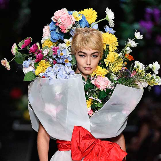 gigi hadid flower bouquet moschino catwalk