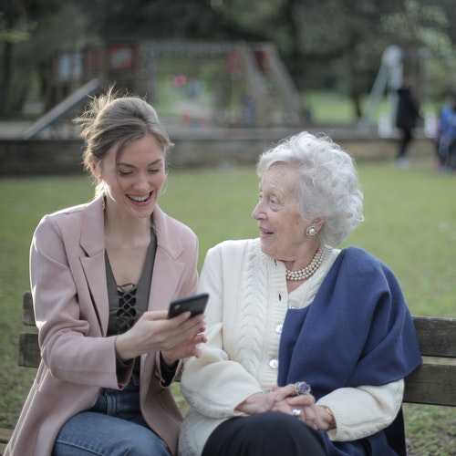 grandmother and girl looking at phone