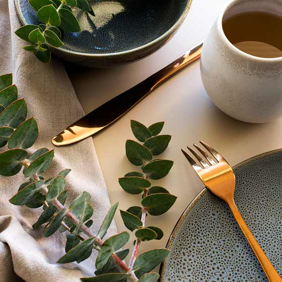 eucalyptus plates and vase on table