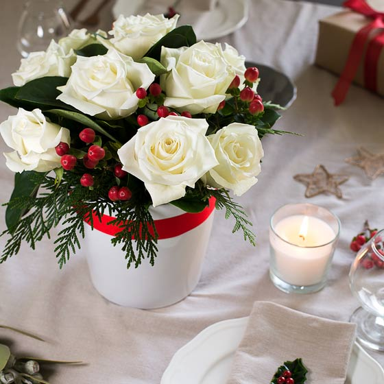 christmas flowers on christmas table