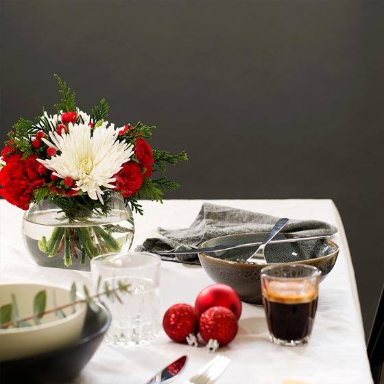 white and red flowers on christmas table