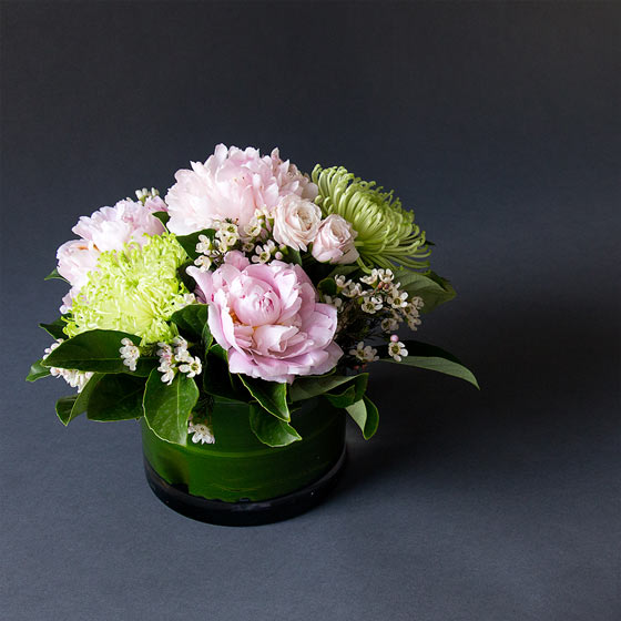 green and pink peony flower arrangement