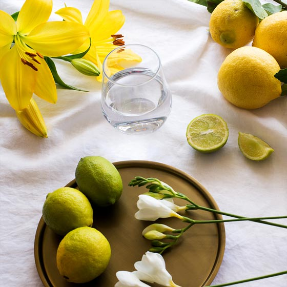 yellow lilies and lemons on white linen