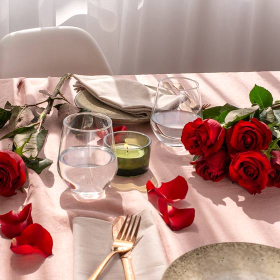 table setting with red roses valentines day