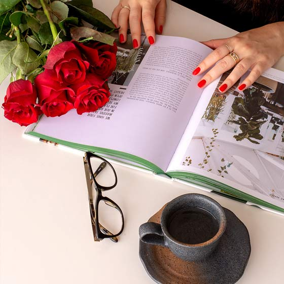 red roses on table with magazine