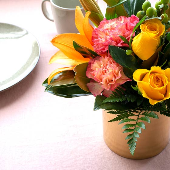 pink yellow and orange flower arrangement on table