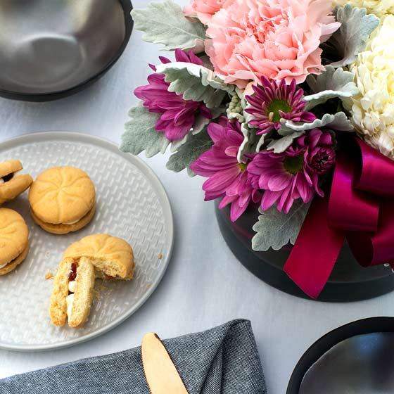 mother's day flowers with afternoon tea on table
