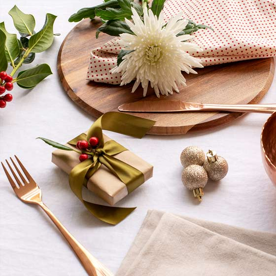christmas table setting with white chrysanthemums